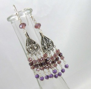 Silver filigree chandelier earrings with pink, purple, and fuchsia Swarvoski cyrstals.