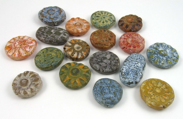 Spiced polymer clay beads with rustic finish.