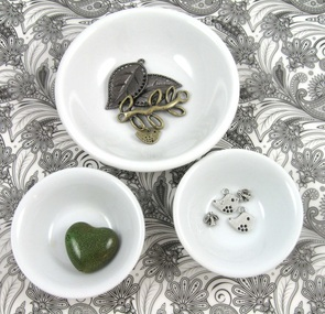 metal and ceramic beads in bowls