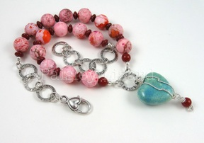 Pink and turquoise necklace designed by Paisley Lizard