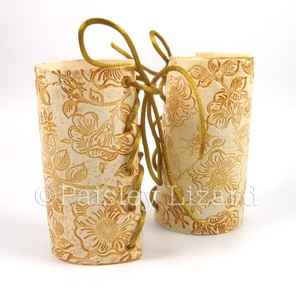 Gilded faux white leather archer cuffs