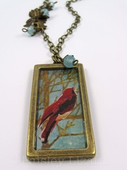 Resin encased collage pendant necklace