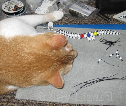 cat napping on bead mat
