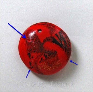 Picture of polymer clay bead with misplaced hole