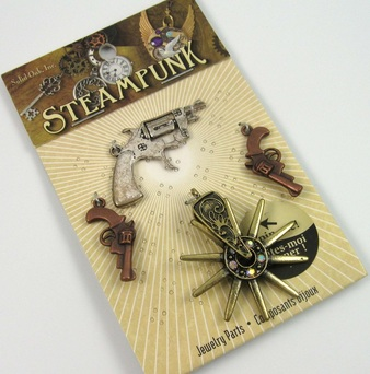 Picture of gun and spur charms in package