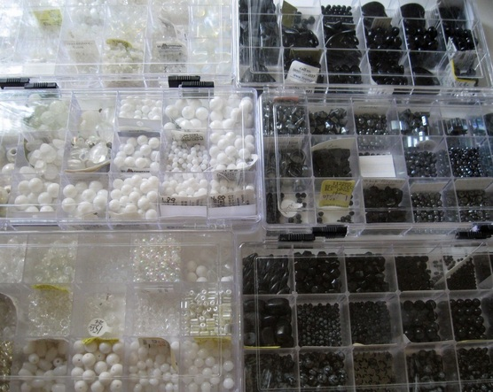 Picture of black and white beads in storage containers