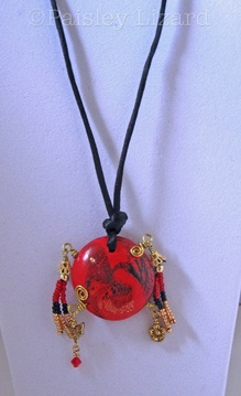 Picture of bead pendant necklace on display stand