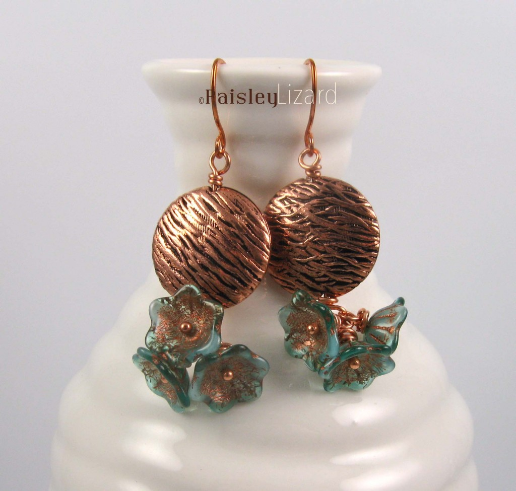 Lichen Blossom earrings on bottle