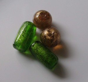 Foiled glass beads