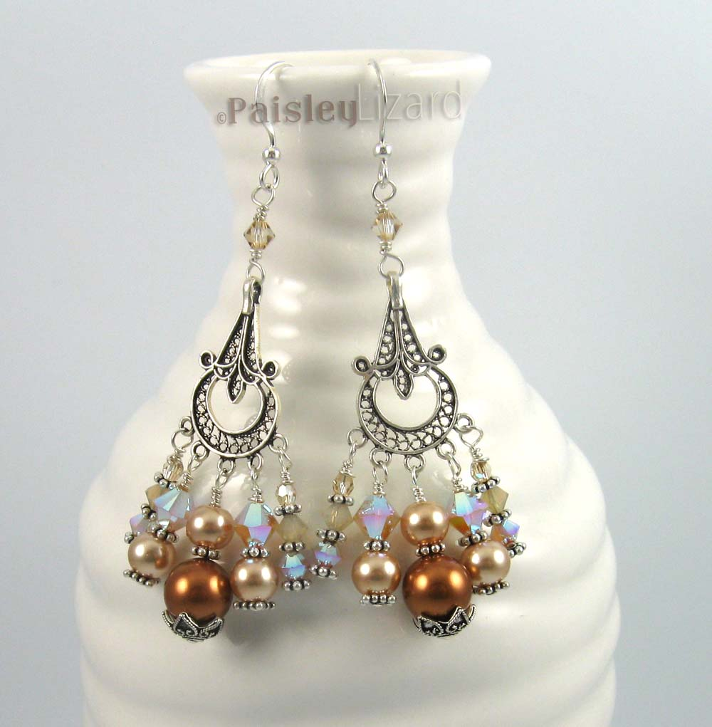 Champagne chandelier earrings on bottle