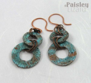 Patina washer earrings on white background