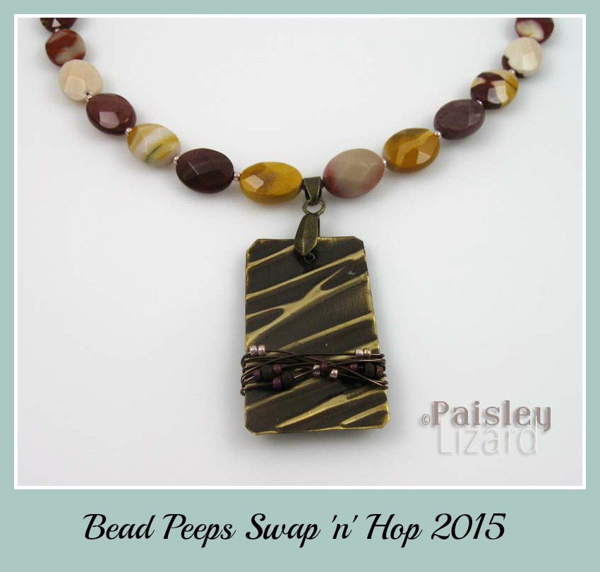 Brass focal with wire wrapped beads