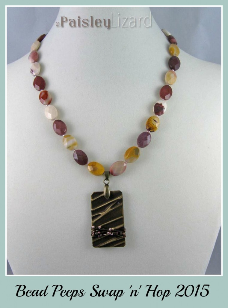 Moukaite bead necklace with brass pendant