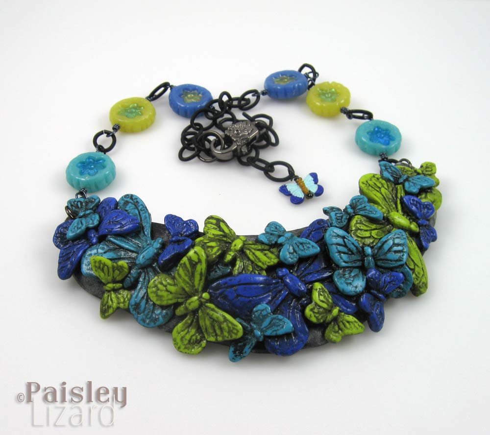 Blue green butterfly collage necklace