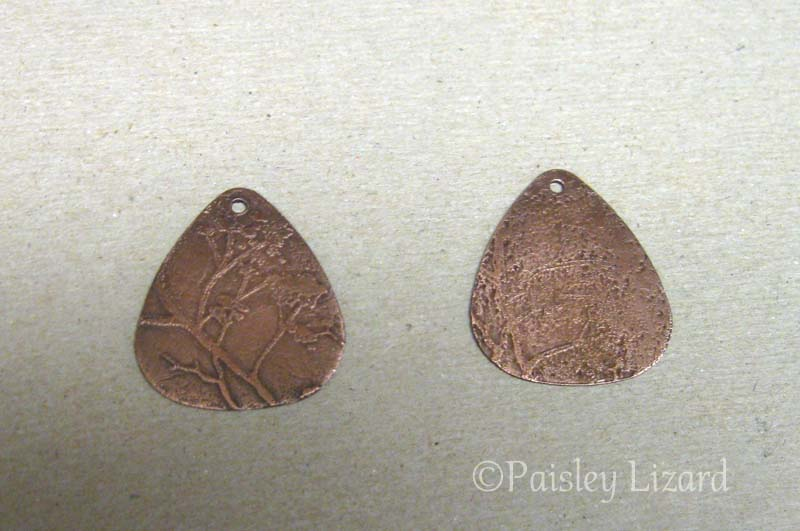 Two pieces of etched copper
