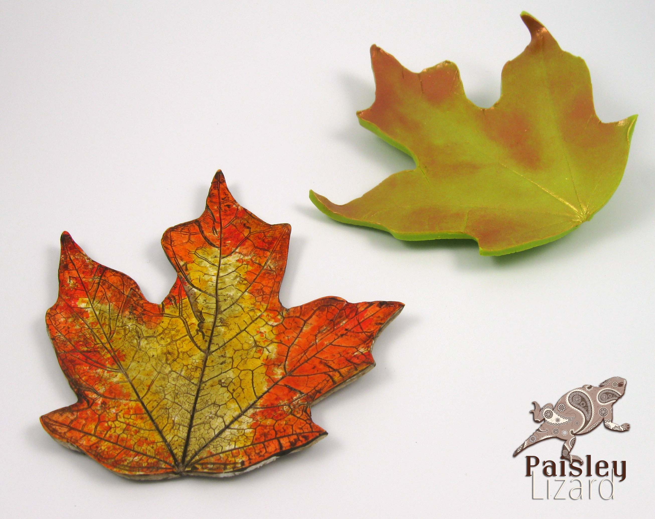 Two polymer clay maple leaves
