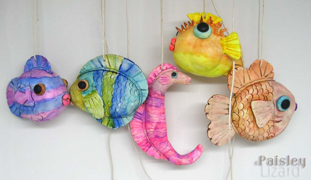 Five colorful fish ornaments