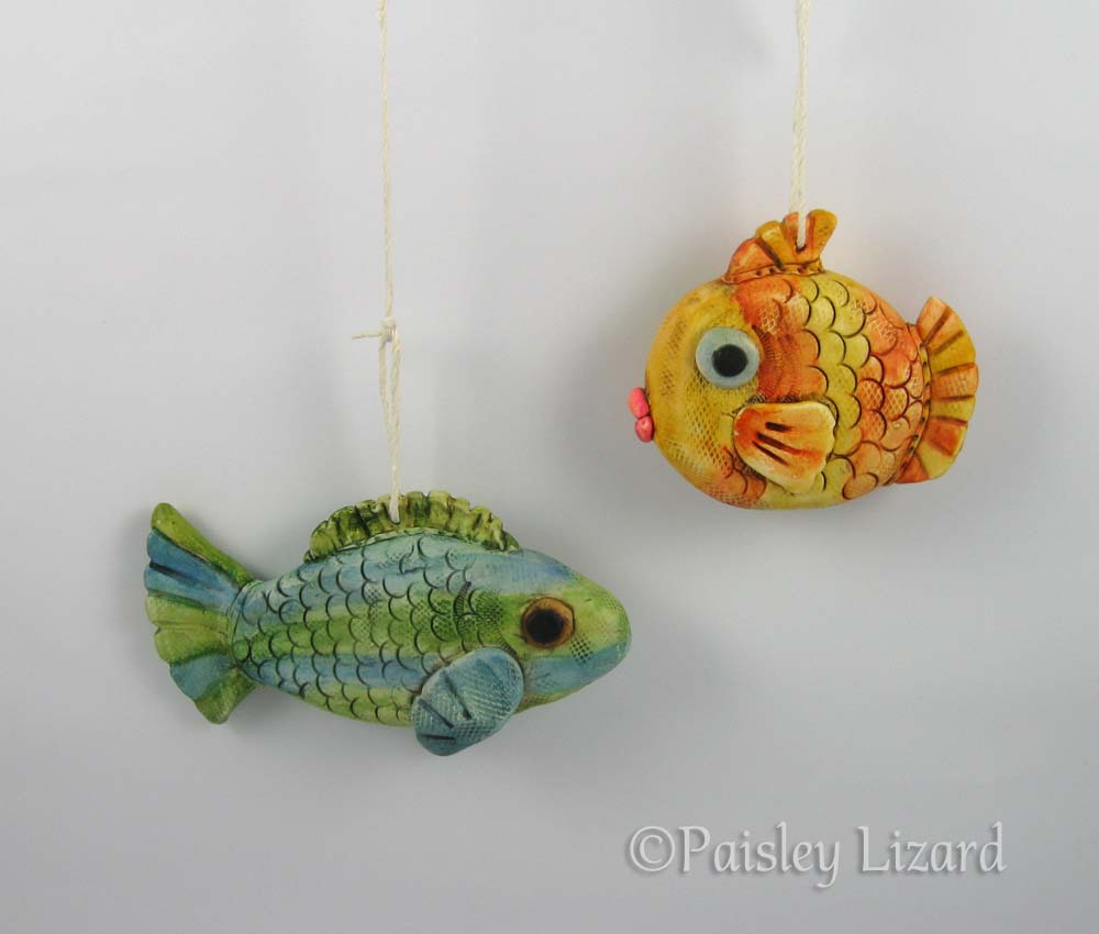 Green fish and orange fish ornaments