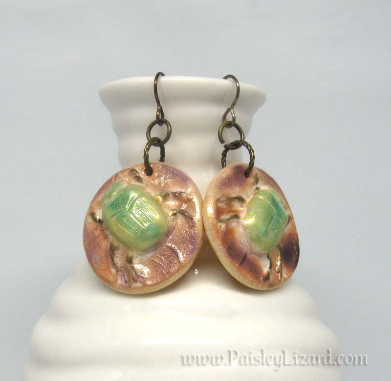 June bug dangle earrings with copper background