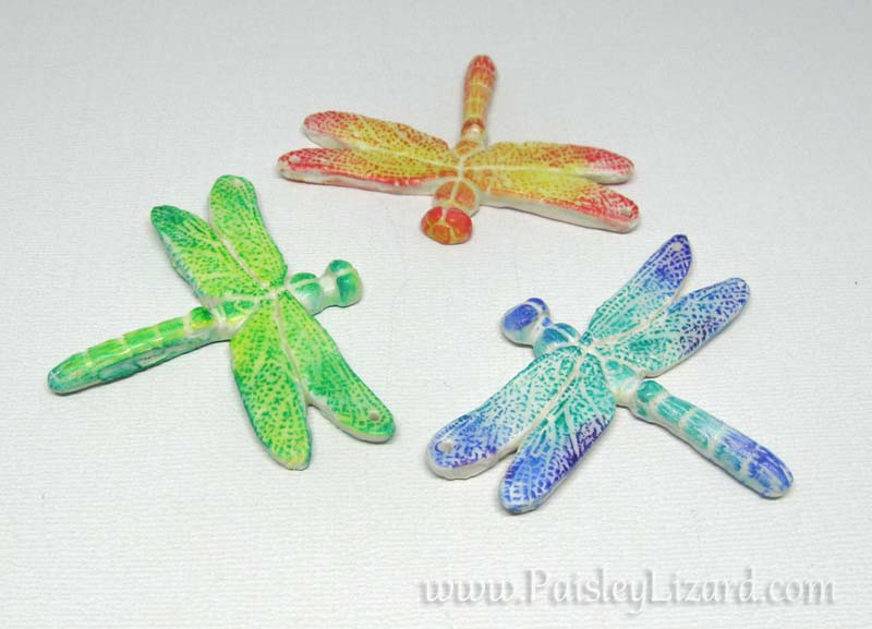 three dragonfly pendants