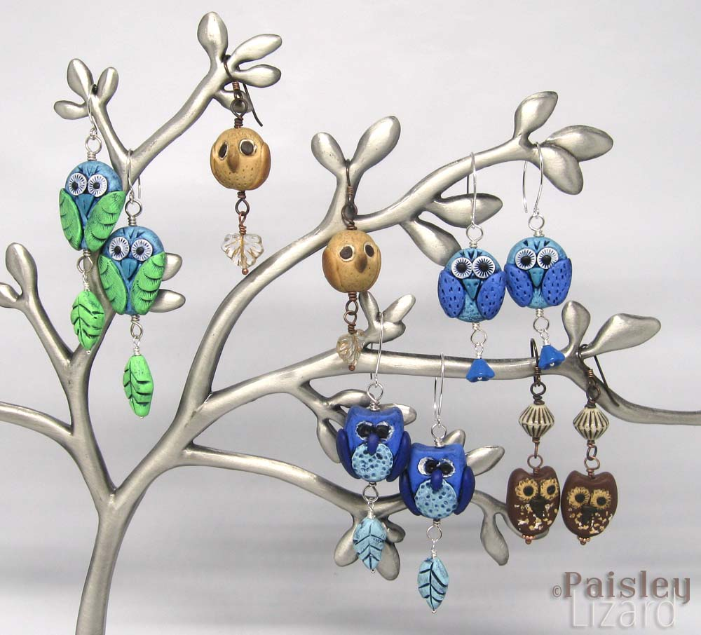 Silver earring tree with assorted owl earrings