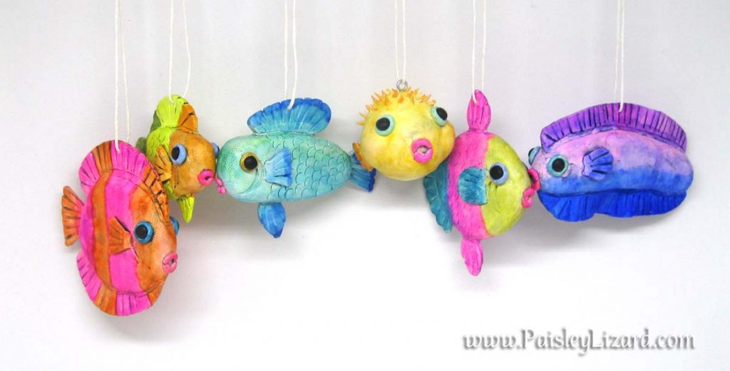 Six fish ornaments hanging on string