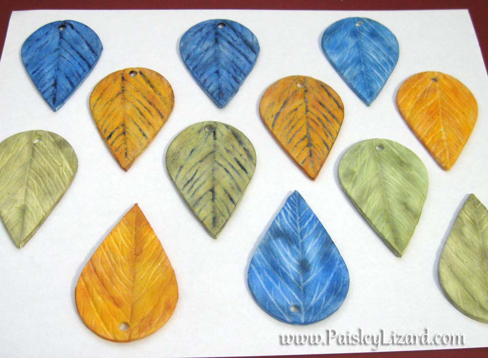 polymer clay leaves in blue, green, and orange