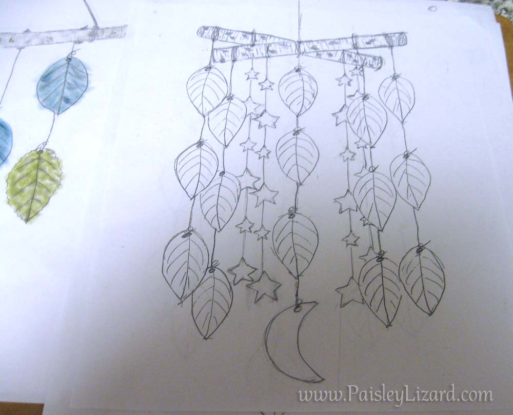 sketch of mobile with stars and moon added to leaves