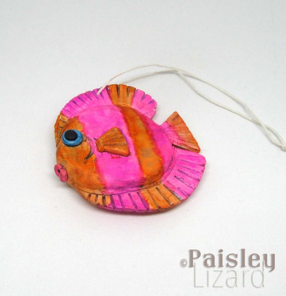 vivid pink and orange tang fish
