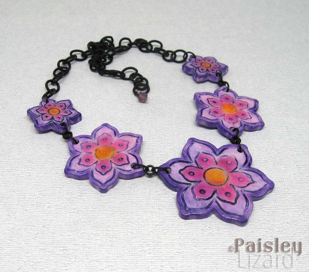 Flowers necklace on white background