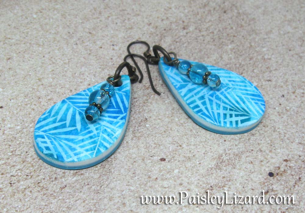 Teal blue batik earrings in sand